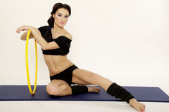 Beautiful sporty woman in black dress slim body with hula hoop royalty free stock images