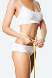 Beautiful sporty woman body with measure Stock Photos