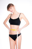 Beautiful sporty woman body with yellow measure on white backgro Stock Image