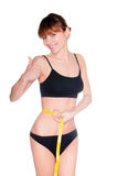 Beautiful sporty woman body with yellow measure on white backgro Royalty Free Stock Photo