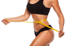 Beautiful sporty woman body with yellow measure on Royalty Free Stock Image