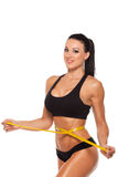 Beautiful sporty woman body with yellow measure on Stock Photo