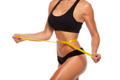 Beautiful sporty woman body with yellow measure on Royalty Free Stock Photos