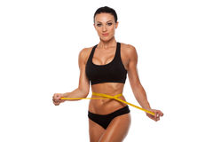 Beautiful sporty woman body with yellow measure on Royalty Free Stock Images