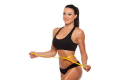 Beautiful sporty woman body with yellow measure on Royalty Free Stock Photography
