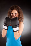 Beautiful sporty woman with box gloves Royalty Free Stock Photography