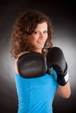Beautiful sporty woman with box gloves Stock Photography