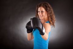 Beautiful sporty woman with box gloves Stock Photos