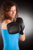 Beautiful sporty woman with box gloves Royalty Free Stock Images