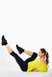 He beautiful sporty woman does exercises on a floor. Fitness. Stock Photos