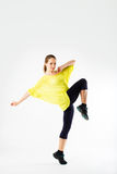 Beautiful sporty woman does exercises Stock Photo