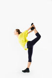 Beautiful sporty woman does exercises Stock Images