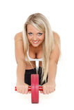 Sporty woman does exercises. Fitness. Stock Photos