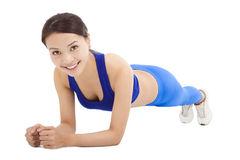 Beautiful sporty woman doing core exercise on the floor Royalty Free Stock Photos
