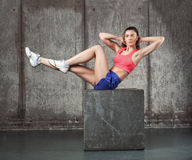 Beautiful sporty woman doing exercise, abs Stock Photos