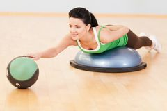 Beautiful sporty woman doing exercise on ball. Stock Image