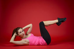 Beautiful sporty woman doing exercise on the floor Stock Photography