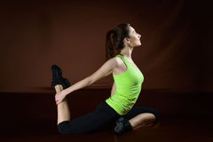 Beautiful sporty woman doing exercise on the floor. Woman exercising workout fitness aerobic exercise posture on studio Royalty Free Stock Image