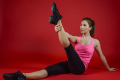 Beautiful sporty woman doing exercise on the floor Royalty Free Stock Photo