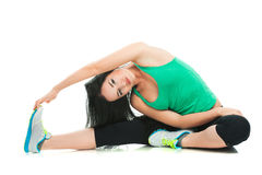 Beautiful sporty woman doing exercise on the floor Stock Photos