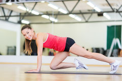 Beautiful sporty woman doing exercise at gym Stock Photography