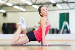 Beautiful sporty woman doing exercise at gym Stock Photos