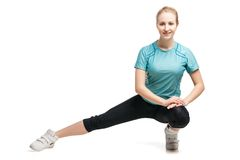 Beautiful sporty woman doing exercise Stock Photo