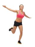 Beautiful sporty woman doing exercise Stock Images