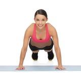 Beautiful sporty woman doing exercise Stock Photos