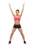 Beautiful sporty woman doing exercise Royalty Free Stock Image