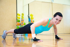 Beautiful sporty woman doing push up exercise in gym Royalty Free Stock Image