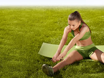 A beautiful sporty woman  doing stretching exercise against natu Royalty Free Stock Image