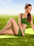 A beautiful sporty woman  doing stretching exercise against natu Royalty Free Stock Images