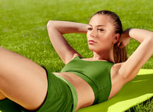 A beautiful sporty woman  doing stretching exercise against natu Stock Photo