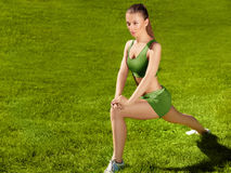 A beautiful sporty woman doing stretching exercise against natur Royalty Free Stock Photo