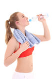 Beautiful sporty woman drinking water Royalty Free Stock Images