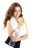 Beautiful sporty woman drinking watter and eating apple Stock Photos