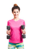 Beautiful sporty woman exercising with two dumbbells Royalty Free Stock Photo