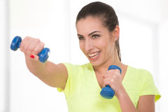 Beautiful sporty woman in gym Royalty Free Stock Photography