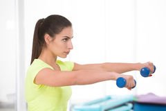 Beautiful sporty woman in gym Stock Images