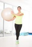Beautiful sporty woman in gym Stock Photo