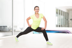 Beautiful sporty woman in gym Stock Photos