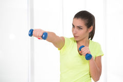 Beautiful sporty woman in gym Royalty Free Stock Photos