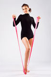 Beautiful sporty woman with a gymnastic ribbon Stock Images