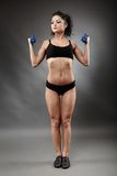 Beautiful sporty woman lifting dumbbells Stock Image