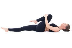 Beautiful sporty woman lying and doing stretching exercise isola Royalty Free Stock Photos