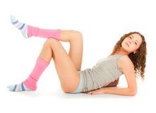 Beautiful sporty woman lying on the floor Stock Photo