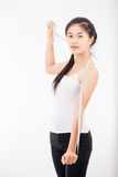 Beautiful sporty woman with measuring Royalty Free Stock Photos