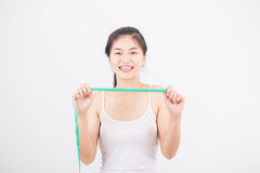 Beautiful sporty woman with measuring Royalty Free Stock Image