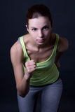 Beautiful sporty woman running over grey. Background Stock Image